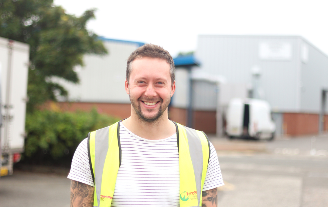 smiling staff member high vis
